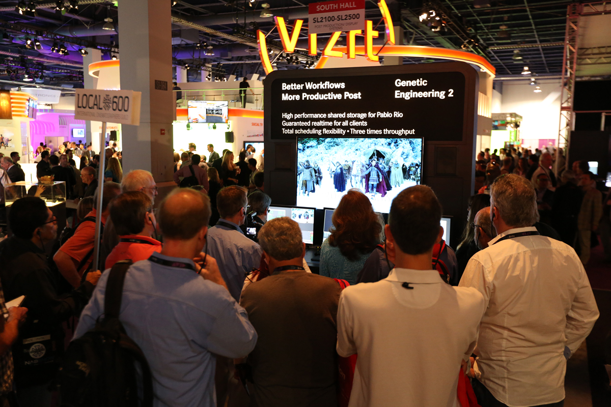 ICG Workflow Tour attendees, led by Stephen Lighthill, ASC, visit the Quantel booth