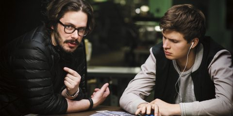 Director Edgar Wright (left) and Ansel Elgort on the set of TriStar Pictures' BABY DRIVER.