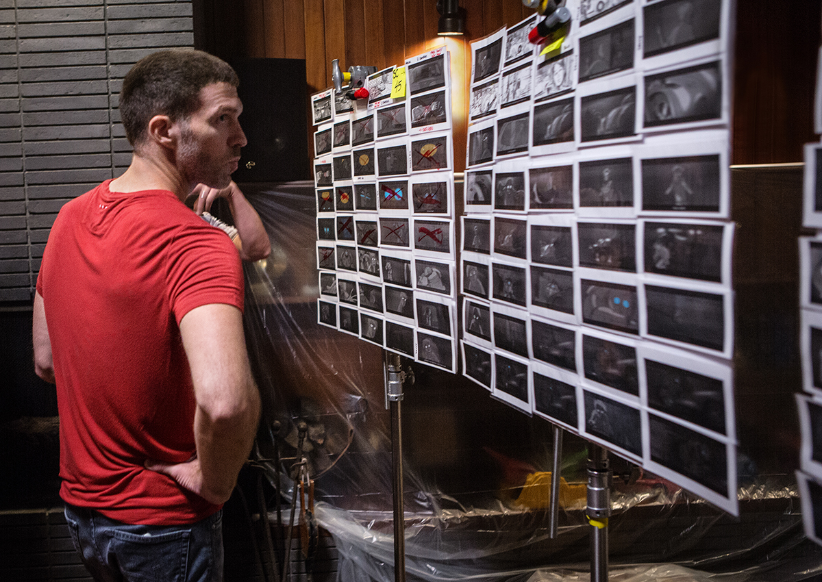 Director Travis Knight examining a storyboarded sequence on set / Photo by Jaimie Trueblood, SMPSP