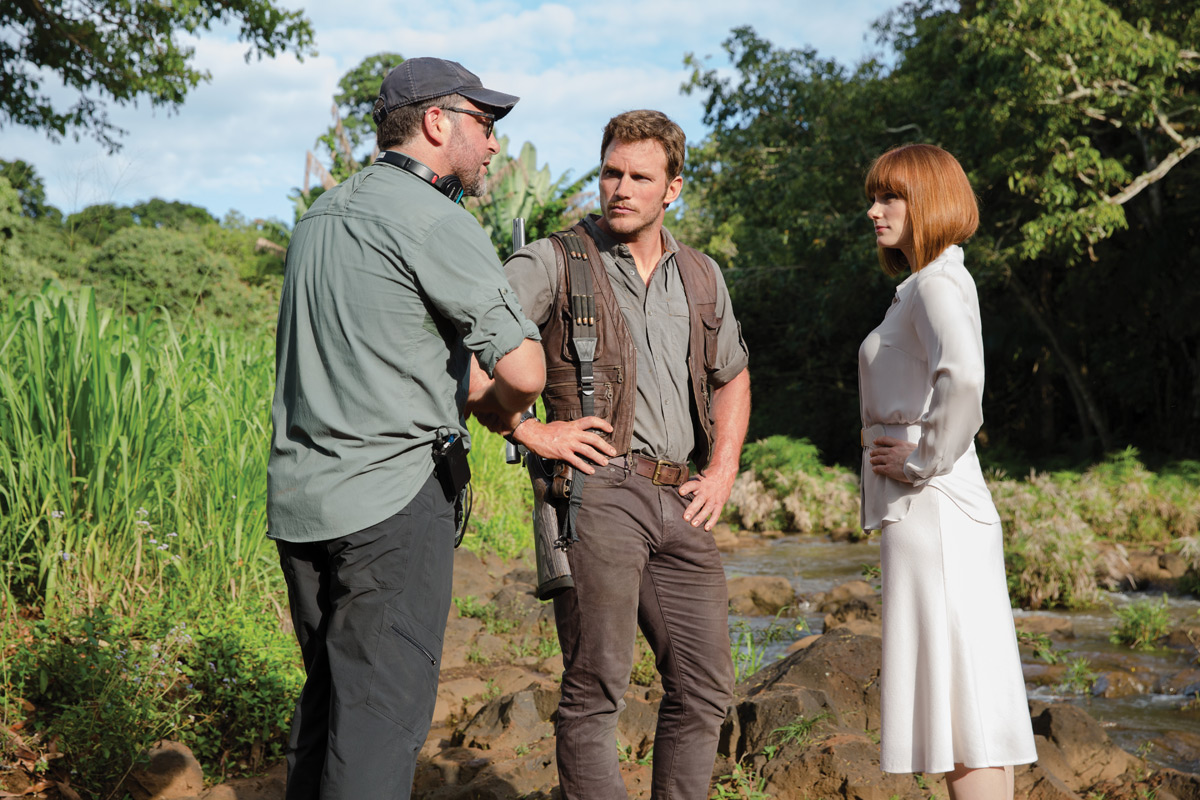 Director Colin Trevorrow (L) discusses a scene with Pratt (middle) and Howard (R) on Kaui location